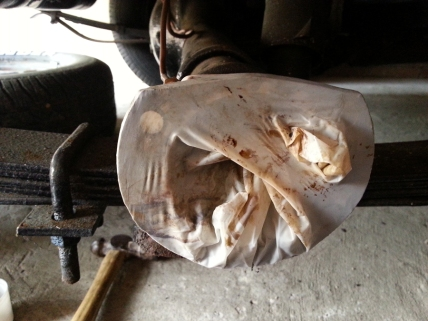 old rubber glove keeping the axle opening clean while I worked on the removed parts.