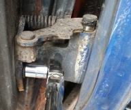 loosening the last bolt on the door at the bottom